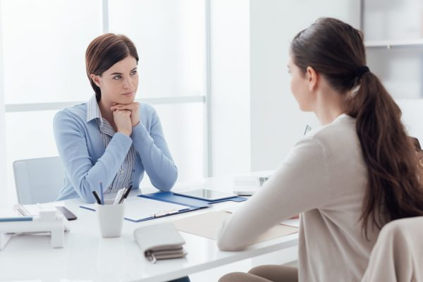 Business-meeting-in-the-office-and-job-interview-a-female-executive-is-meeting-the-candidate-and-talking