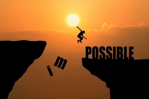 man-jumping-impossible-possible-cliff-sunset-background-business-concept-idea_1323-265